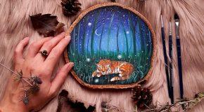 Des morceaux de bois avec des paysages peints pour un hommage à la nature