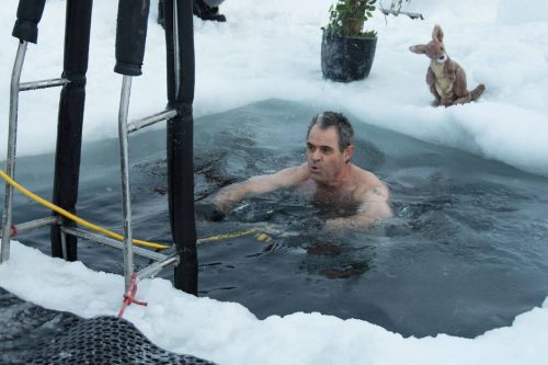 "This handout photo taken on June 19, 2018 and released by the Australian Antarctic Division (AAD) on June 21 shows Barry Balkin taking a dip in a swimming hole prepared at the Casey research station as Antarctic researchers welcome the winter solstice by plunging into icy waters as part of a ""mad tradition"" as they look forward to brighter days after weeks of darkness. In temperatures of -22 degrees Celsius (-7.6 degrees Fahrenheit), researchers stationed at Australia's Casey base marked midwinter's day by cutting a small pool in the thick ice before stripping off and jumping in. - -----EDITORS NOTE --- ONE TIME USE --- RESTRICTED TO EDITORIAL USE - MANDATORY CREDIT ""AFP PHOTO / GEORGE BRETTINGHAM-MOORE / AUSTRALIAN ANTARCTIC DIVISION"" - NO MARKETING - NO ADVERTISING CAMPAIGNS - DISTRIBUTED AS A SERVICE TO CLIENTS - NO ARCHIVES TO BE USED EXCLUSIVELY FOR AFP STORY  AUSTRALIA-ANTARCTICA-SOLSTICE-WEATHER  / AFP / AUSTRALIAN ANTARCTIC DIVISION / George BRETTINGHAM-MOORE / -----EDITORS NOTE --- ONE TIME USE --- RESTRICTED TO EDITORIAL USE - MANDATORY CREDIT ""AFP PHOTO / GEORGE BRETTINGHAM-MOORE / AUSTRALIAN ANTARCTIC DIVISION"" - NO MARKETING - NO ADVERTISING CAMPAIGNS - DISTRIBUTED AS A SERVICE TO CLIENTS - NO ARCHIVES TO BE USED EXCLUSIVELY FOR AFP STORY  AUSTRALIA-ANTARCTICA-SOLSTICE-WEATHER"